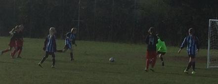 Olivia running at goal